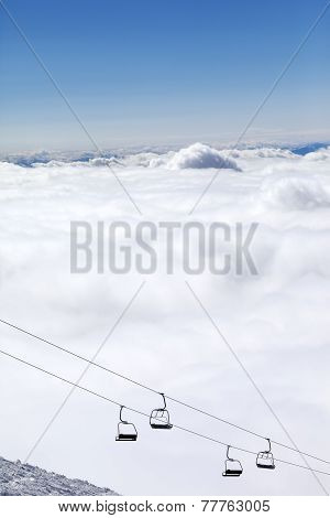 Mountains Under Clouds And Chair-lift