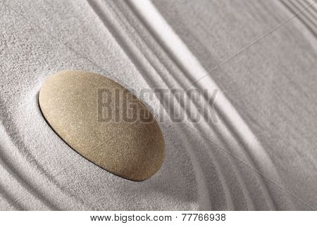 harmony and balance in Japanese zen garden, round stone and lines in sand