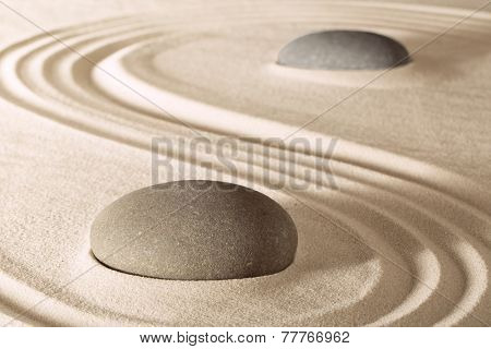 harmony and purity in zen garden. Stones and lines in sand create serenity and balance. Spirituality spa and wellness background