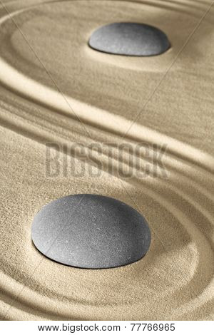 spa wellness background zen stone and sand garden raked lines lead to balance and purity. Massage stones therapy.