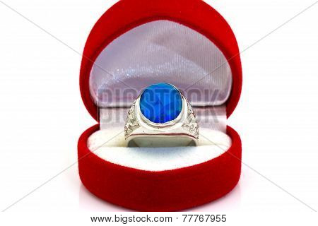 Ring Of The Jeweler With Blue Sapphire And Brilliants On A White Background