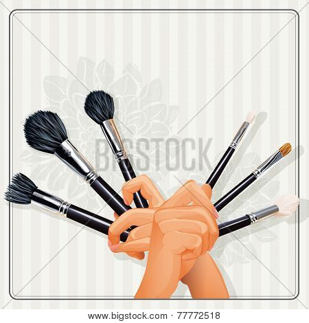 hands holding a brush for makeup
