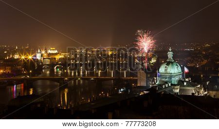 View On Prague Bridges And Vltava River With Fireworks At Night