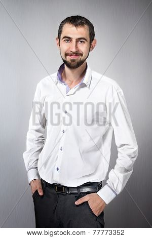 Handsome Young Man Standing With Hands In His Pockets