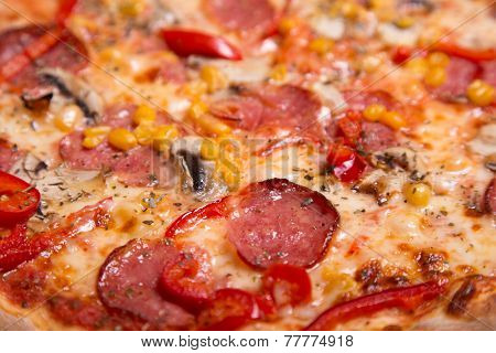 Close-up shot of tasty American pizza with pepperoni and mushrooms, selective focus