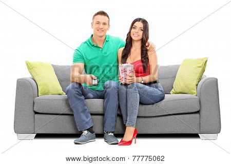 Couple watching television and eating popcorn isolated on white background