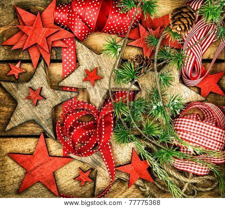 Christmas Ornaments, Wooden Stars, Red Ribbons And Pine Tree Branches