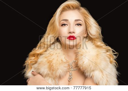 Blond Hair. Beautiful Sexy Blonde Girl. Beauty isolated on a Black Background