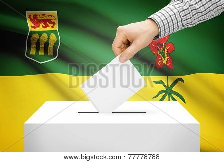 Voting Concept - Ballot Box With National Flag On Background - Saskatchewan