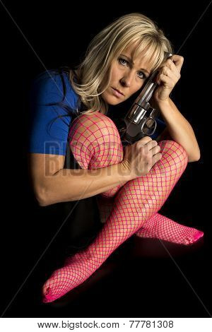 Woman Blue Shirt And Pink Fishnets Hold Gun Against Head