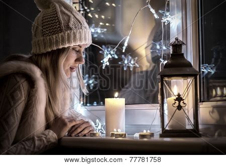 Woman in white hat in eve Christmas and New Year