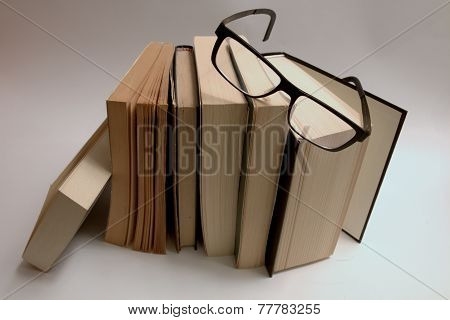 Set of old books with glasses