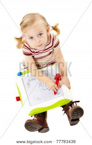 Little Girl Drawing On A Board