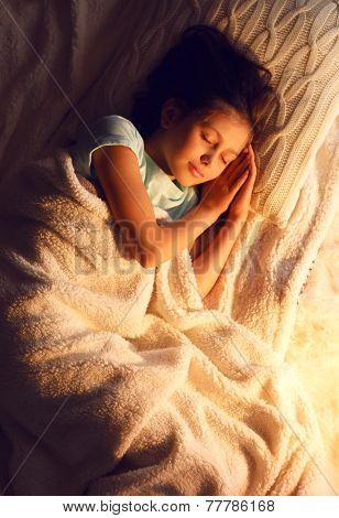 Cute little girl asleep at Christmas night