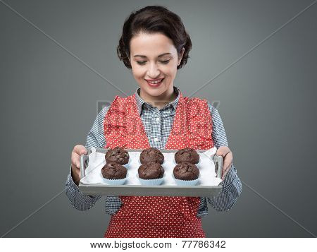 Smiling Woman Serving Chocolate Muffins
