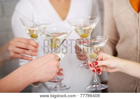 Woman hands with glasses of martini close-up