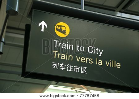 Train to city sign at airport