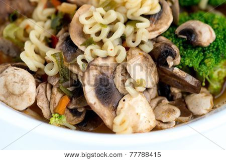 Macro Of Japanese Ramen Noodles With Vegetables And Broth
