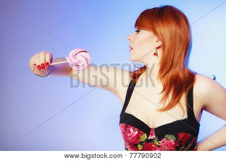 Redhair Girl Holding Sweet Food Lollipop Candy On Blue.