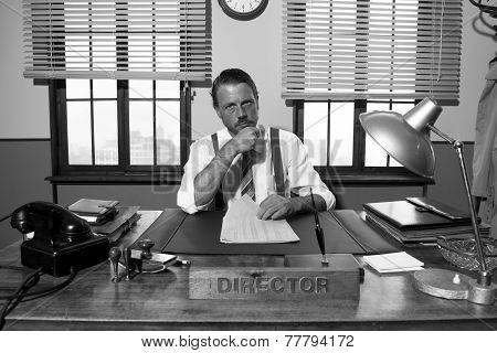 Pensive Director Working At Desk