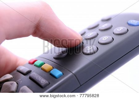 hand pressing remote control button isolated on white