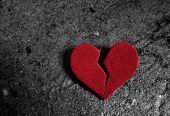 picture of broken heart  - A broken red heart on dark background - JPG