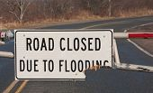 foto of flood  - Broken road closed due to flooding sign - JPG