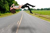 image of floating  - Beautiful young woman floating above a road or highway - JPG