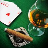 picture of cigar  - Cigar chips for gamblings drink and playing cards on green - JPG