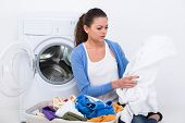 pic of washing-machine  - Sad young woman with clothes near washing machine at home - JPG