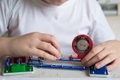 foto of pre-teen boy  - a Teen boy at home with electronic project - JPG