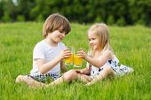 pic of little boys only  - Little girl and boy outdoor summer drink juice - JPG