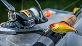 stock photo of fishing rod  - Fishing lure used for fishing freswater predators supported onto a fishing rod - JPG