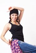 picture of beanie hat  - Cute hipster teenage girl with beanie hat posing looking at camera - JPG