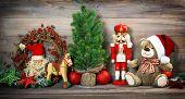pic of nutcrackers  - nostalgic christmas decoration with antique toys teddy bear and nutcracker - JPG