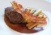 picture of chateaubriand  - Fine tenderloin steak with asparagus back lit - JPG
