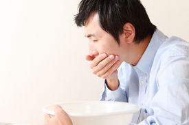 image of vomiting  - portrait of middle aged Japanese man vomit - JPG