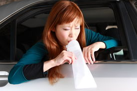 picture of vomiting  - concept shot of young Japanese woman vomiting by carsickness  - JPG