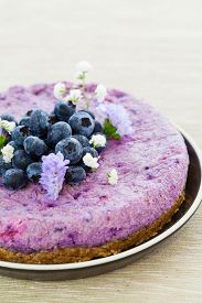 stock photo of brazil nut  - Vegan raw blueberry cake with brazil nuts and almonds - JPG