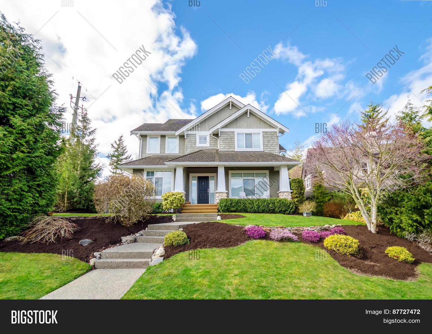 Luxury house beautiful landscaping image photo bigstock for Beautiful homes photo gallery