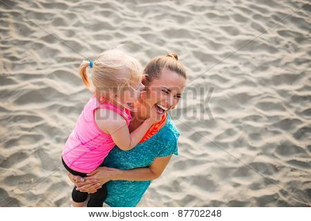 Healthy Mother And Baby Girl On Beach Having Fun Time