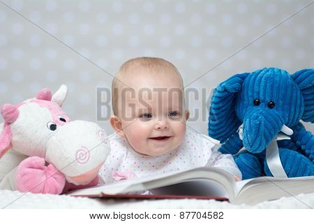Baby Girl Reading A Book