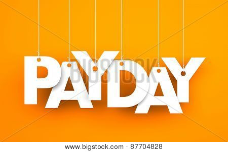 Payday word - suspended by ropes on orange background