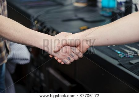 Strong firm handshake in barbershop