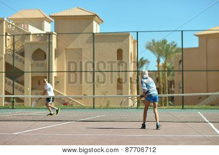 playing at tennis court
