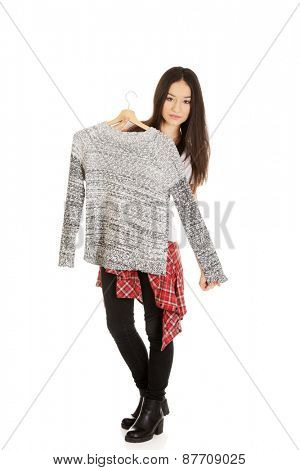 Teen with sweater thinking what to dress.