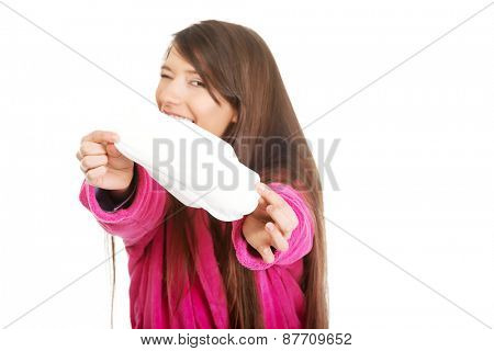 Caucasian woman in pink bathrobe with menstruation pad.