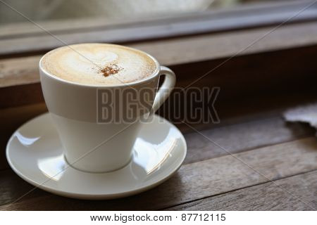 Black coffee or espresso in white cup in coffee shop, Coffee break in office or after meeting, bitter of fresh black coffee, No sugar in cup for diet and popular drink in restaurant or coffee shop.