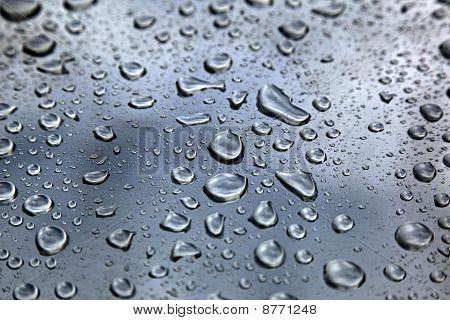 Rain drops on metal