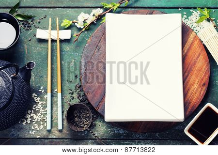 Asian food background (black iron tea set and chopsticks)